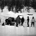 Courtesy Lauren Cooper, Colorado Department of Transportation | Avalanche mitigation crew members prepare to leave dynamite at the Seven Sisters area of Loveland Pass in January 1953.