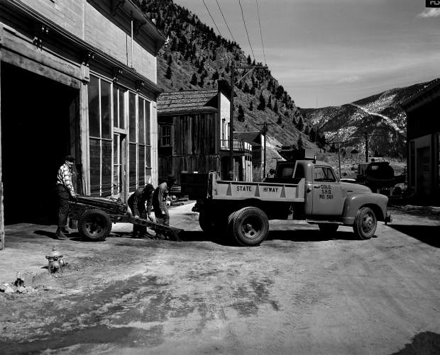 Courtesy Lauren Cooper, Colorado Department of Transportation | Members of the state highway department set up a 75-millimeter Howitzer for avalanche mitigation work in Silver Plume in March 1953.