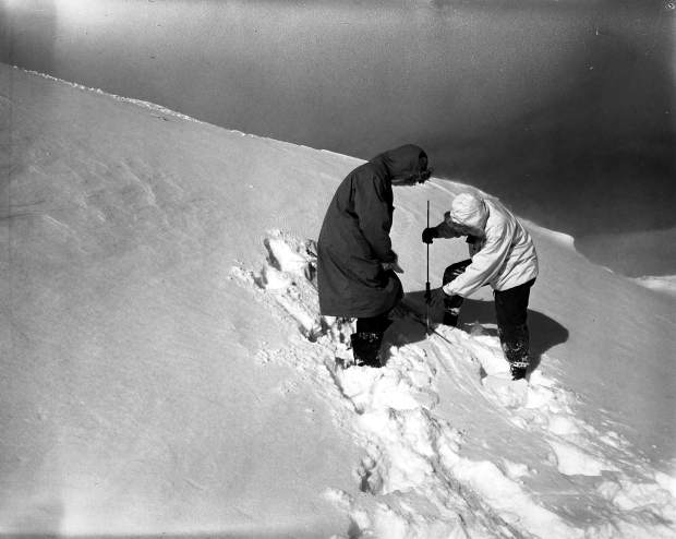 Courtesy Lauren Cooper, Colorado Department of Transportation | Avalanche mitigation crew members assess the stability of the snowpack on Loveland Pass with a peneprometer in January 1953.