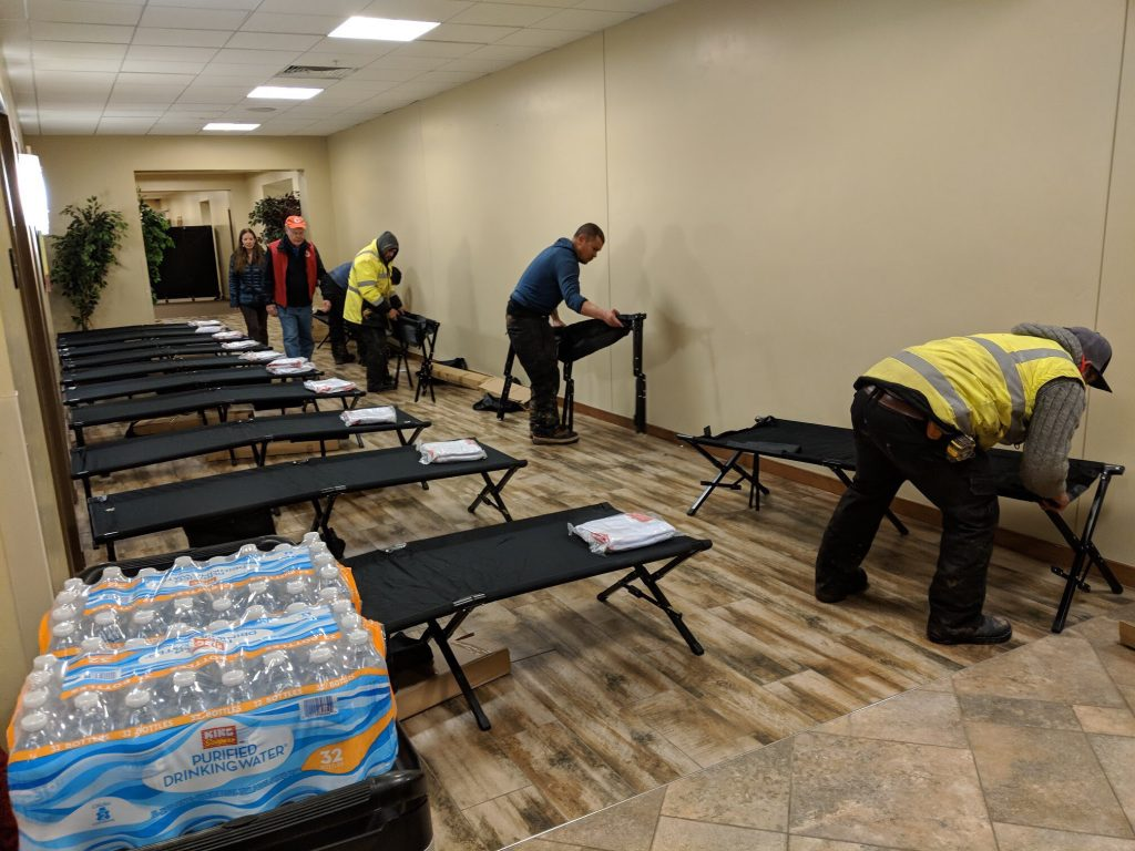 Emergency workers set up cots at the Edwards Interfaith Chapel for residents of Old Edwards Estates who were forced to evacuate Thursday night after a natural gas leak.