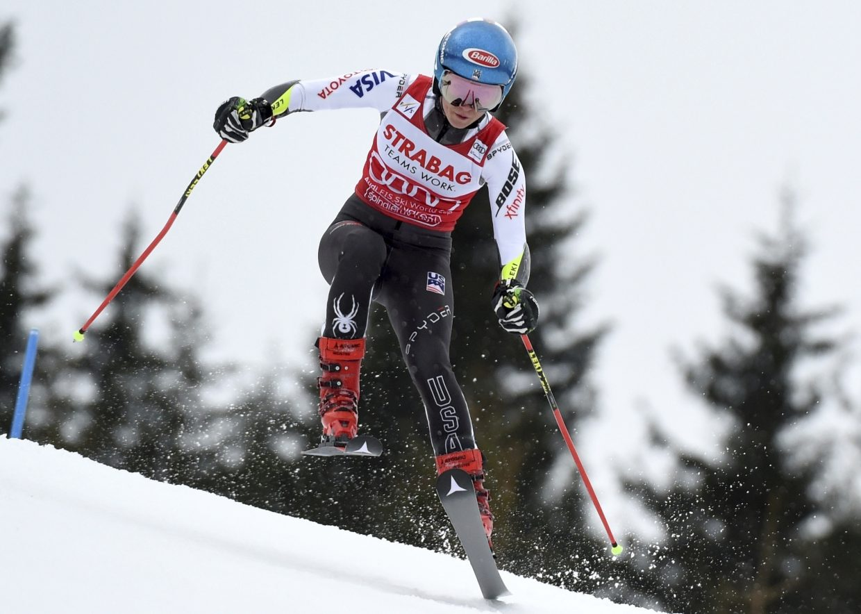 Mikaela Shiffrin charges down the hill during the women's World Cup giant slalom, in Spindleruv Mlyn, Czech Republic, on Friday. Though she finished third, Shiffrin all but locked up the season giant-slalom title, which would be the first of her career.