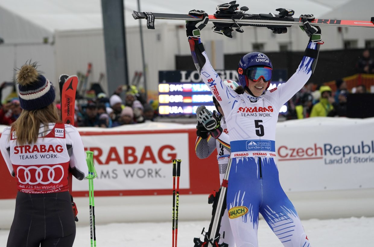 Slovakia's Petra Vlhova, right, celebrates while Mikaela Shiffrin looks on after winning Friday's World Cup giant slalom, in Spindleruv Mlyn, Czech Republic. While Shiffrin has ruled the women's World Cup this season, Vlhova has been a fierce competitor.