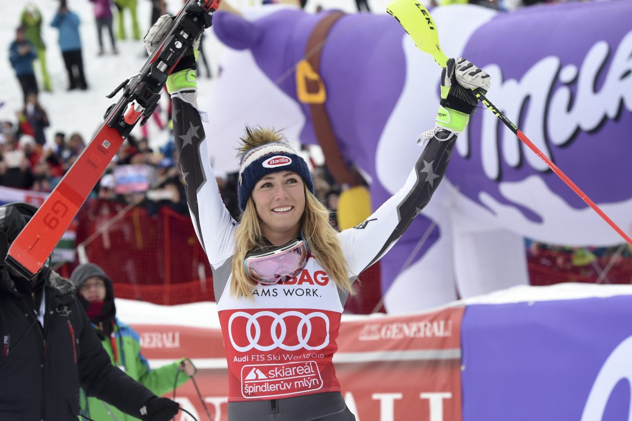 Mikaela Shiffrin celebrates after winning Saturday's World Cup women's slalom in Spindleruv Mlyn, Czech Republic, on Saturday. That is her 15th World Cup win of the season, a new record.