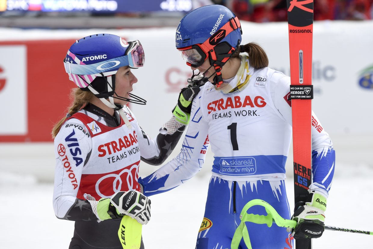 Mikaela Shiffrin, left, and Slovakia's Petra Vlhova share a moment in the finish corral after Shiffrin won Saturday's World Cup slalom in the Czech Republic. Vlhova finished third.