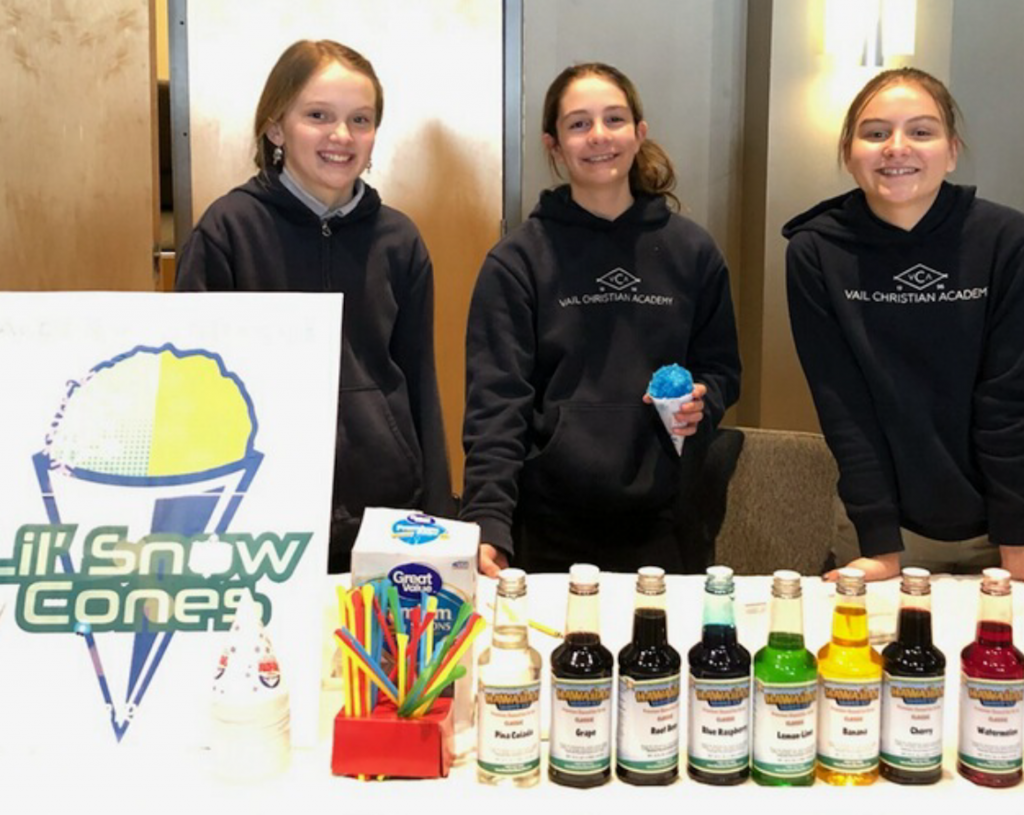 Lily Greshko, Alden Wyatt and Brodie Smith sold $185 worth of snowcones for $1 each. They made the most money during VCA's Entrepreneur Day.