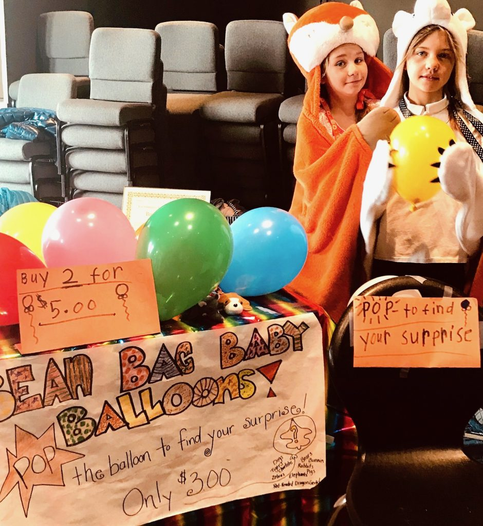 Twin fourth graders Ary and Karis Alexander and their Balloon Stomp Surprise Store.