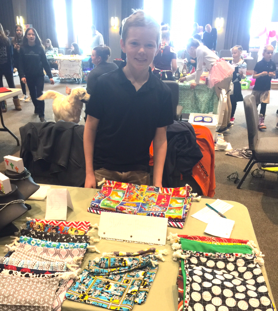 A fifth grader sells swag bags he made during Home Economics class.
