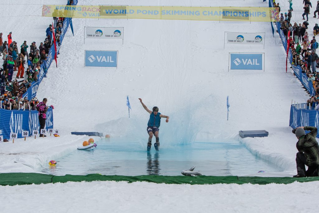 Alex Hall, X Games Gold Medalist from Park City Utah competes in Sunday's World Pond Skimming Championships.