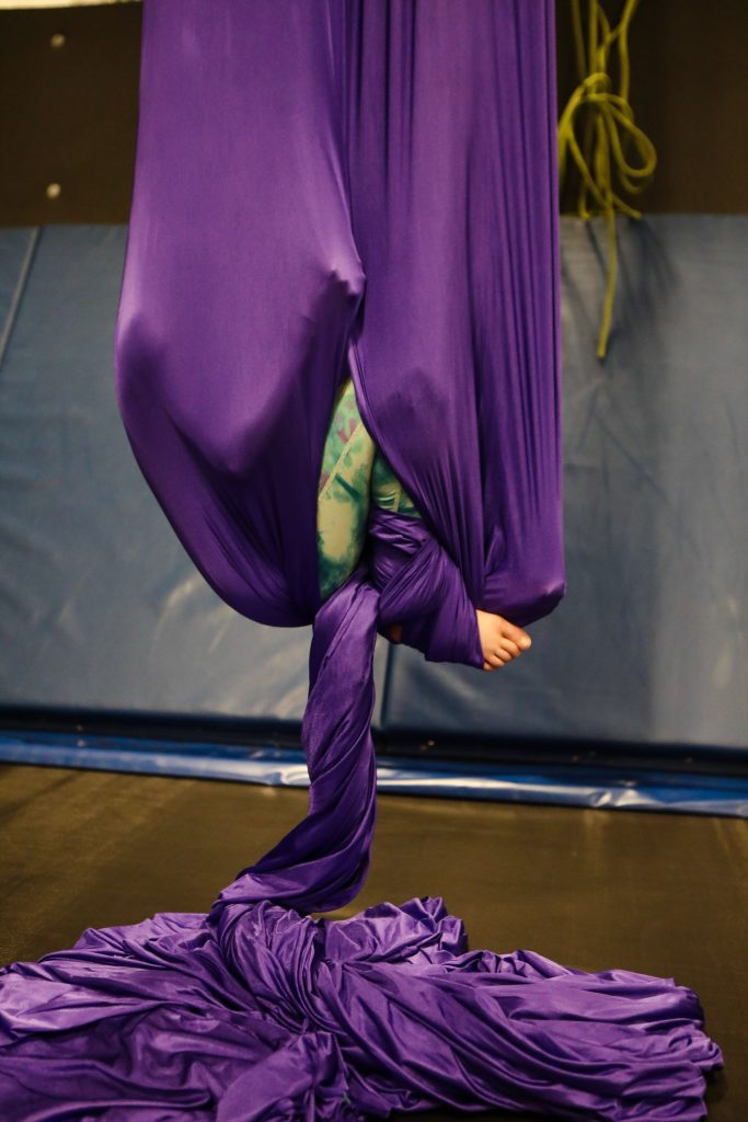 Addie Kisker, 10, of Edwards cocoons herself during the open gym at Mountain Recreation Tuesday in Edwards. Instructors are there to teach and supervise acrobatics.