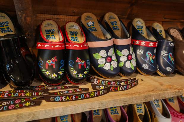 The clogs are made in Sweden and hand-painted by Tessa at the store.