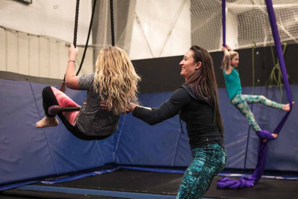 Instructor of the Circus Fun Drop-in session, Alicia Kelley, helps Annika Hurst, 10, of Edwards work on her moves on the trapeze Tuesday at the Mountain Recreation field house in Edwards. The open session has instructors teaching and supervising aerial acrobatics in a safe environment.