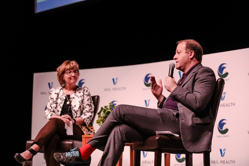 Colorado Gov. Jared Polis speaks with Eagle County Commissioner Chair Jeanne McQueeney during a discussion on mental health Friday at Battle Mountain High School in Edwards. Vail Health has pledged $60 million throughout the next decade.