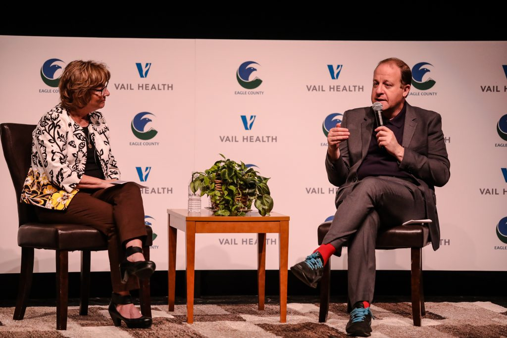 Colorado Gov. Jared Polis speaks with Eagle County Commissioner Chair Jeanne McQueeney during a discussion on mental health Friday at Battle Mountain High School in Edwards. In 2018, 17 people committed suicide in Eagle County, up more than 183 percent.