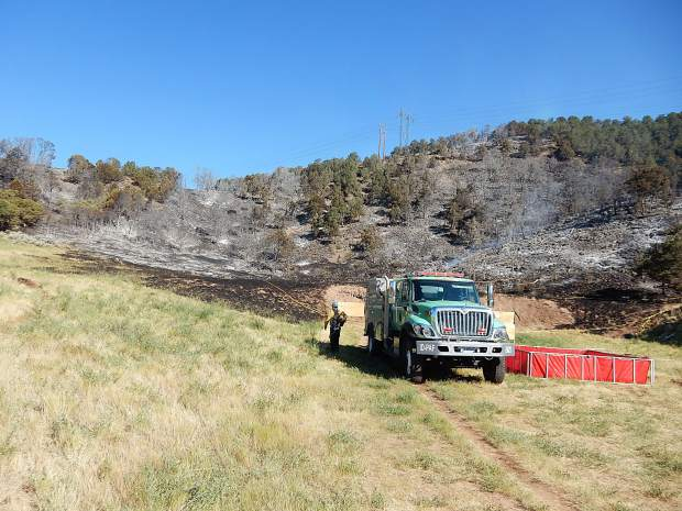 Firefighters mop up at the Basalt shooting range on July 4. The fire originated there on the evening of July 3. Now the legal proceedings involving the couple accused of starting the fire are heating up.