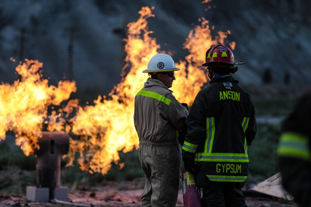 Arlen Thompson, left, with Black Hills Energy instructs Lt. Eric Anson with the Gypsum Fire Department how to approach a gas fire from an above ground line Tuesday in Gypsum.
