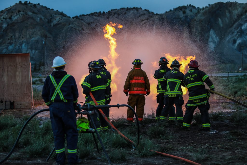 Arlen Thompson with Black Hills Energy leads a group of firefighters on how to approach a natural gas fire Tuesday in Gypsum.
