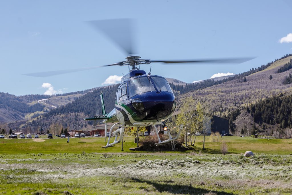 A helicopter hovers above the ground Saturday on a field adjacent to the Colorado Mountain College campus in Edwards.