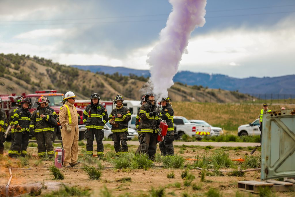 Firefighters test the fire extingushers loaded with Purple-K during a training exercise through Black Hills Energy Tuesday in Gypsum. Testing it before has two purposes, one, to make sure it's working and second to know the wind direction, which is vital for extinguishing natural gas fires.