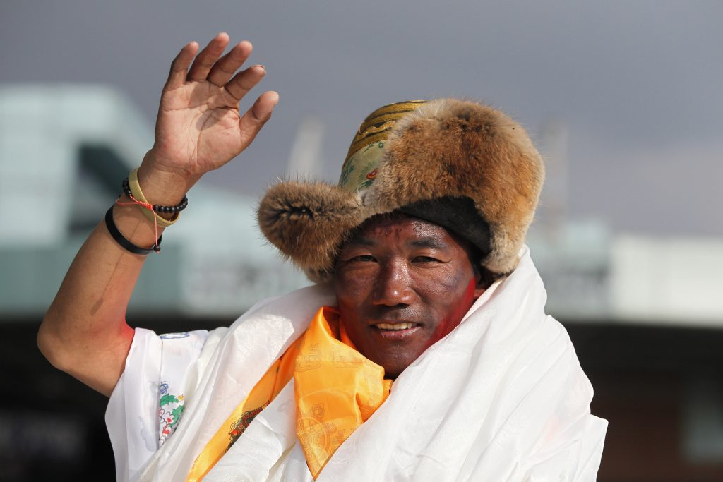 Sherpa climber scales Mount Everest for record 23rd time