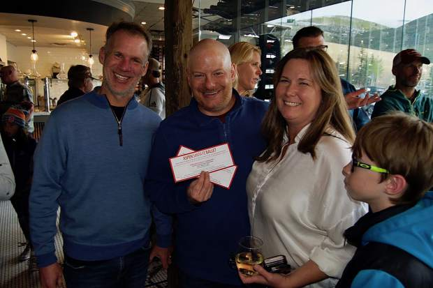 Rob Grems and Vail Valley Lacrosse Club board members Dave Smiley and Tina Petersen celebrated winning raffle prizes at the Vail Valley Lacrosse Club benefit at Sauce on the Creek in Avon.