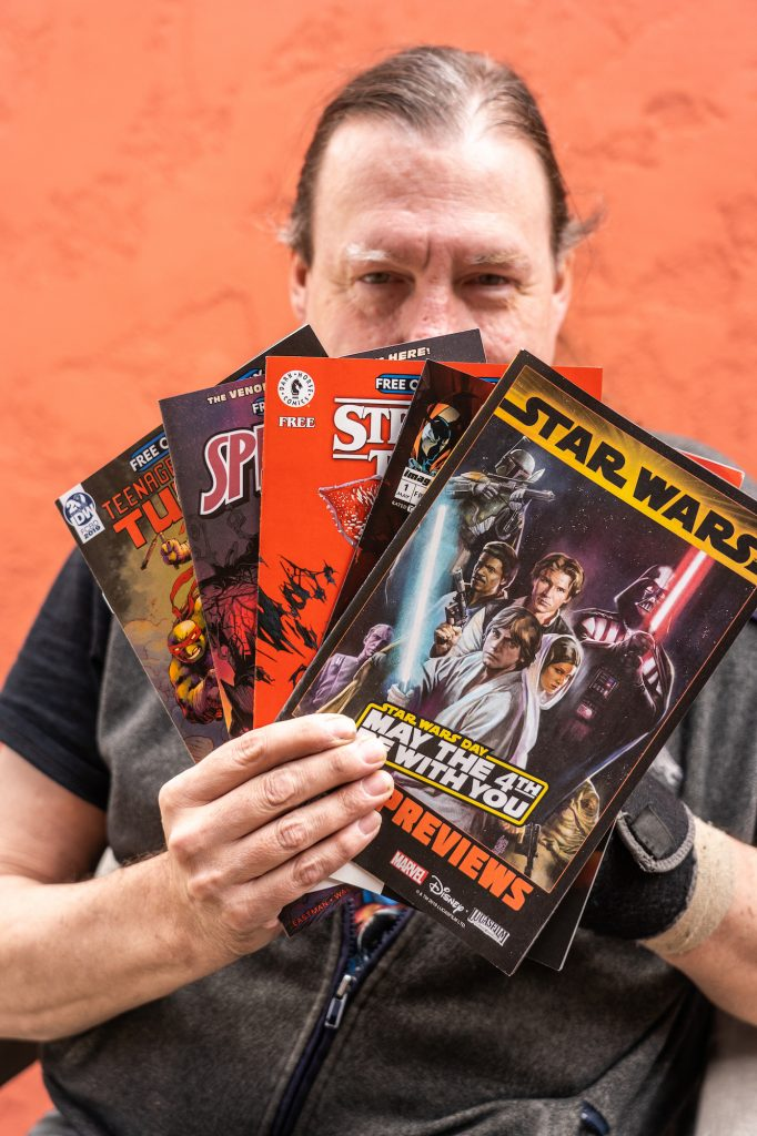 cheap for discount 4023c 8baf9 Eagle Valley Music and Comics store owner Tom Robbins displays several of  the free comics that will be given away on Free Comic Book Day on Saturday.