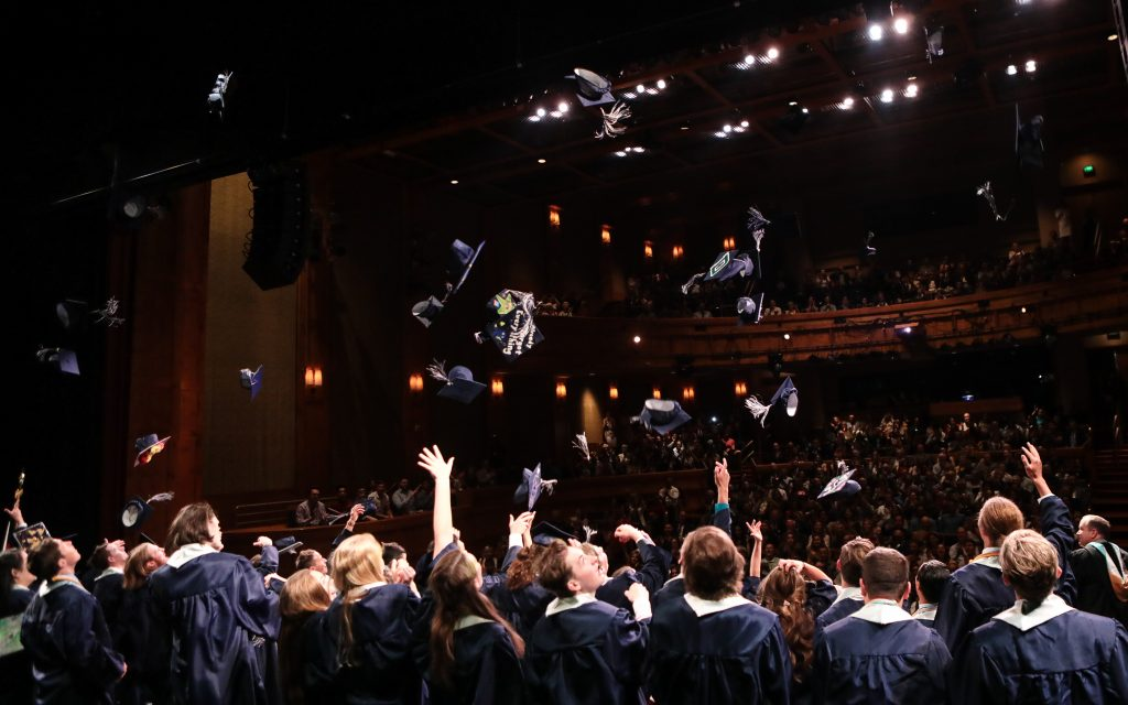 Vail Christian's Class of 2019 toss their caps in the air, symbolizing the end of their high school careers Saturday in Beaver Creek.