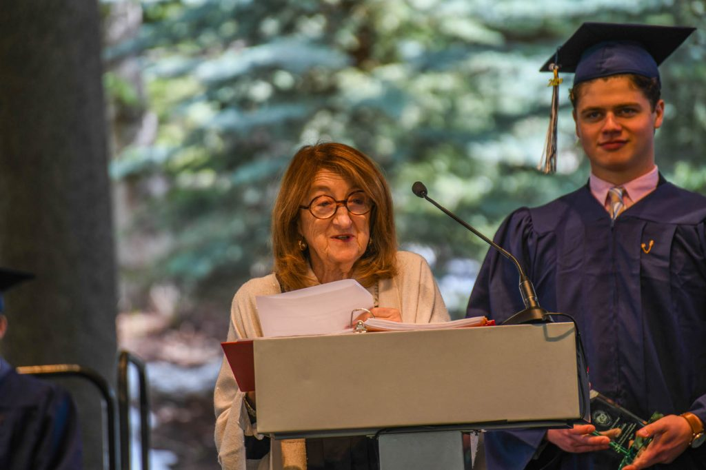 Sally Johnston presents the award named in her honor to senior Emma Blakslee at Friday's commencement.