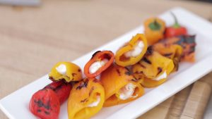 Grilled peppers stuffed with goat cheese