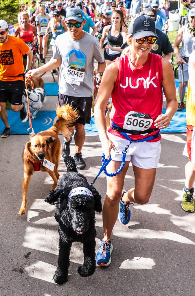 Stacy Lile of Arkansas competes with her dog, Boeing, in the Rocky Dog Trail Run for the GoPro Mountain Games Thursday in Vail. Junk is the official headband of the GoPro Mountain Games.