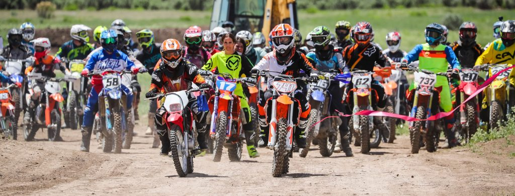Siena Miller, left front, and her brother Windham, right front, and their mother Mary Miller on with Nicole Bradford, lead more than 100 motorcycles through a ribbon Saturday as Rocky Mountain Sport Riders opened their summer season and dedicated a track to Paul Miller.