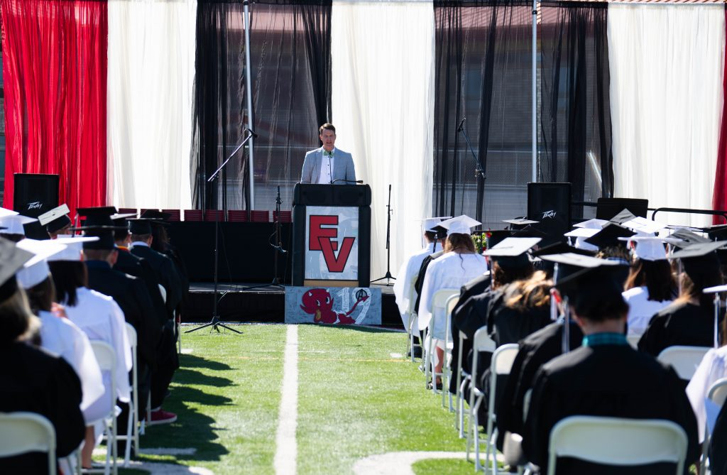 Principal Gregory Doan gives the welcome speech to his graduating class of 190.