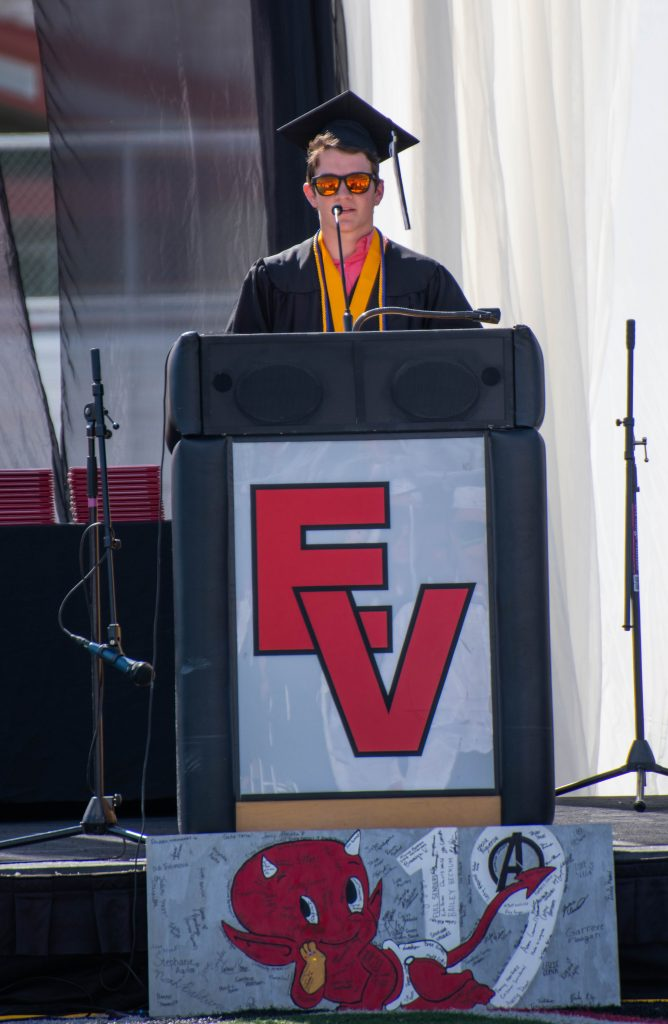 Luke Morrissey gives the valedictorians' address on Saturday.