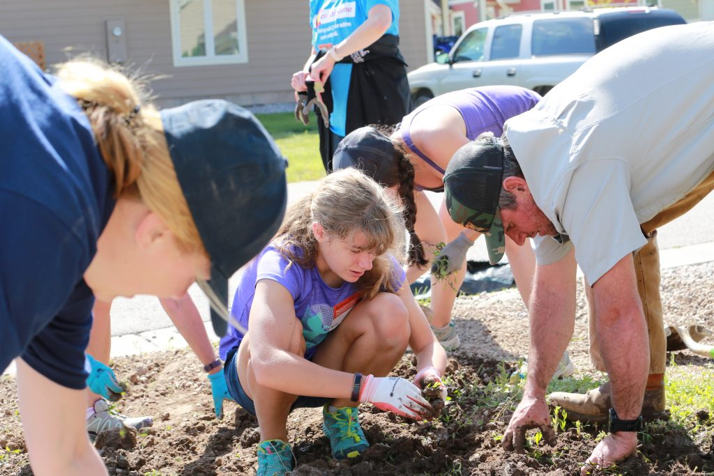 Volunteers help plants and families take root during Thursday's Habitat for Humanity Legislative Build Day.
