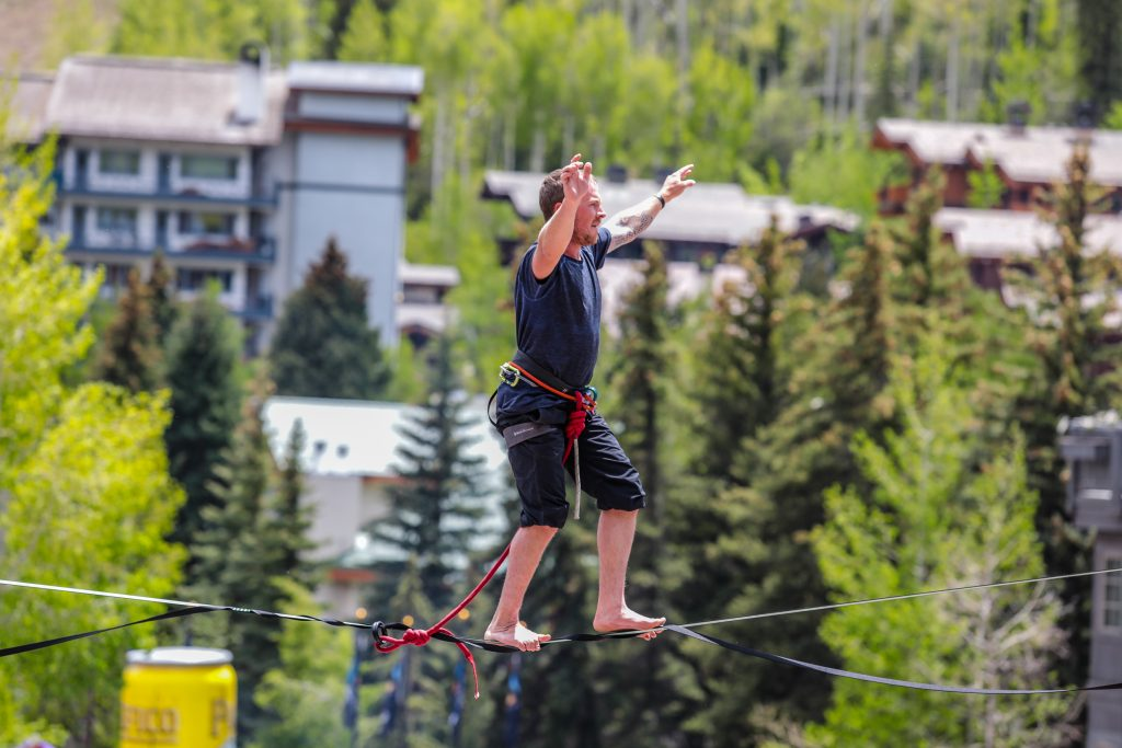 Dakota Collins gets high above the crowd for the GoPro Mountain Games Highline Speed Walk in Vail. The goal was to walk across the highline the fastest. If the competitor fell twice they were disqualified.
