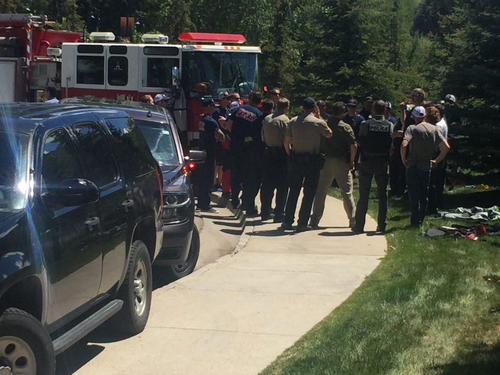 First responders debrief after an incident on the Eagle River in Avon.