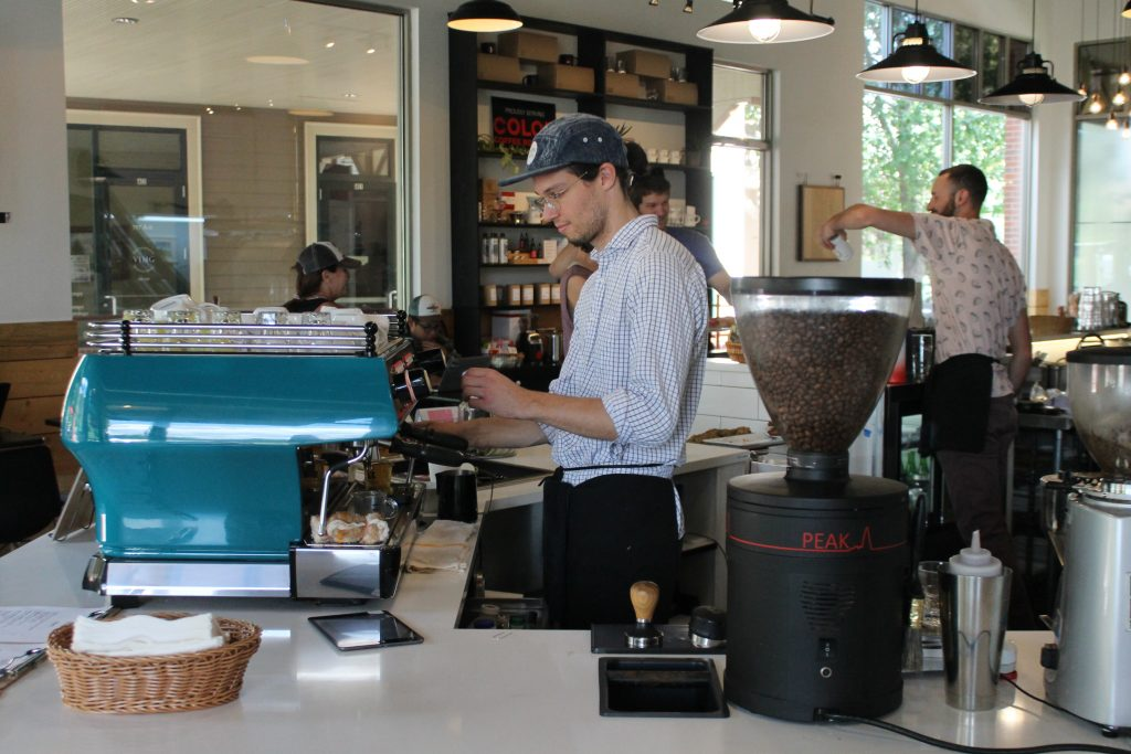 A barista at work at Color Coffee in Eagle.