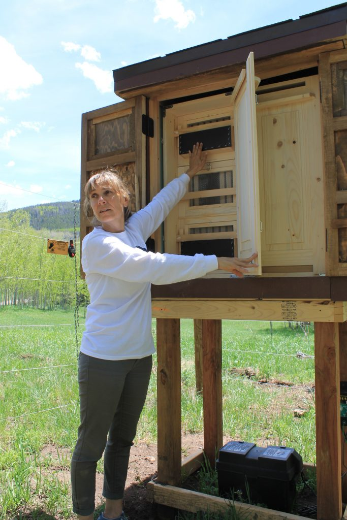 Knapp Ranch beekeeper Carmen Weiland demonstrates how Eurpean hive design allows her to collect honey and other hive products with minimal disturbance to her bees.