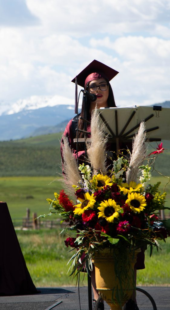 Kim Covarrubias gives the Welcome Address at Red Canyon's graduation.