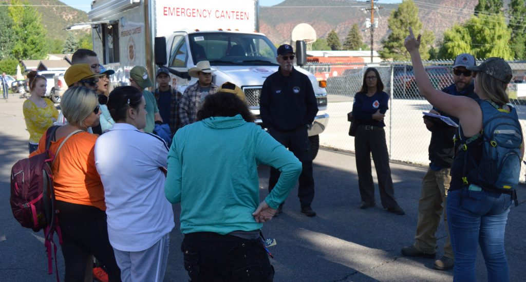 Volunteers gather in Gypsum for a briefing before fanning out to search for Tayler Esslinger.