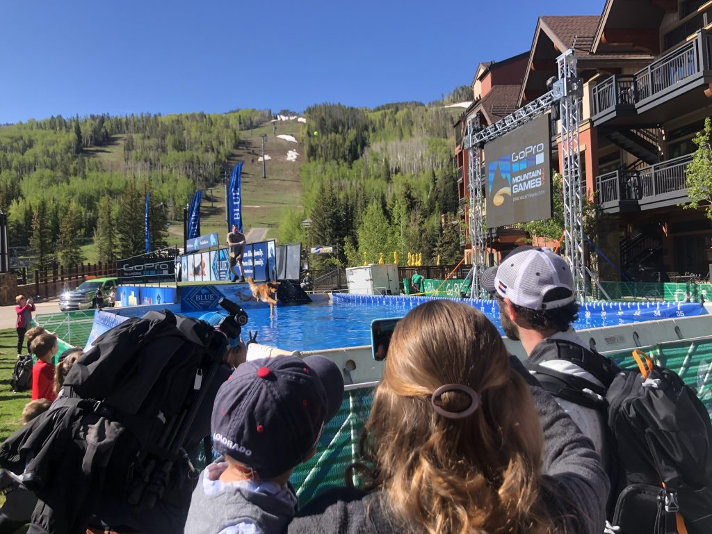 A mother and her infant son watch the DockDogs competition at the GoPro Mountain Games