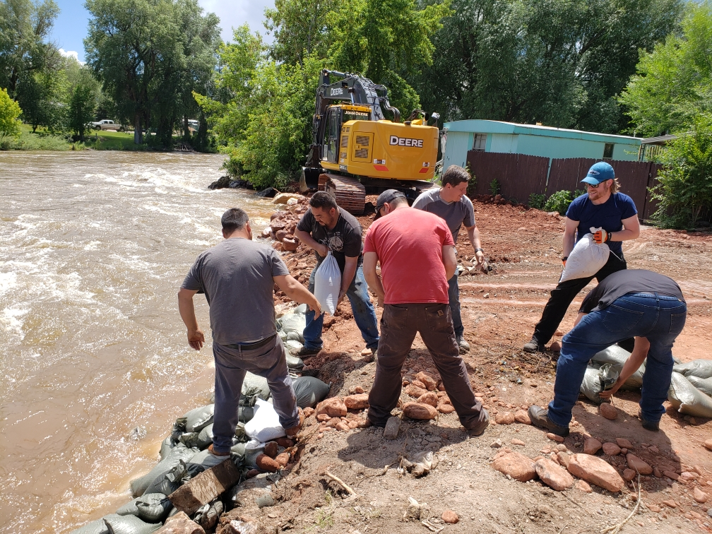 A crew from the town of Gypsum piles sandbags along the Eagle River at the Riverview Mobile home Park. Last night one residence was evacuated when high water levels eroded more than 200 yards of dirt.