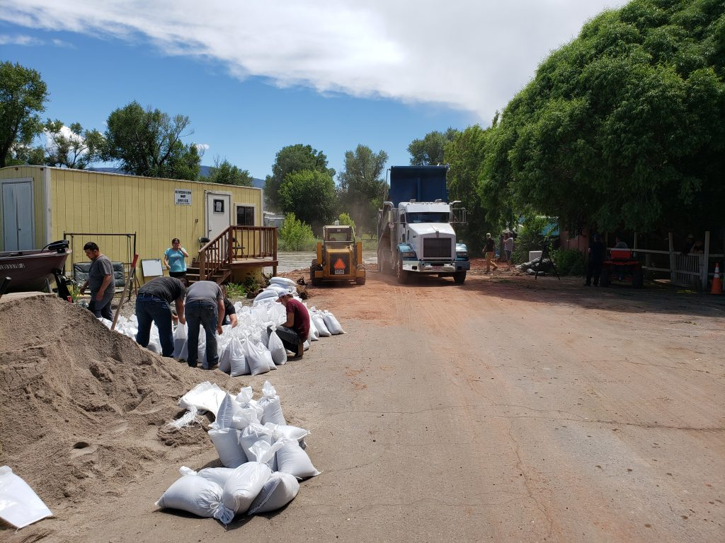 Crews stockpile sandbags at the Riverview Mobile Home Park in Gypsum.