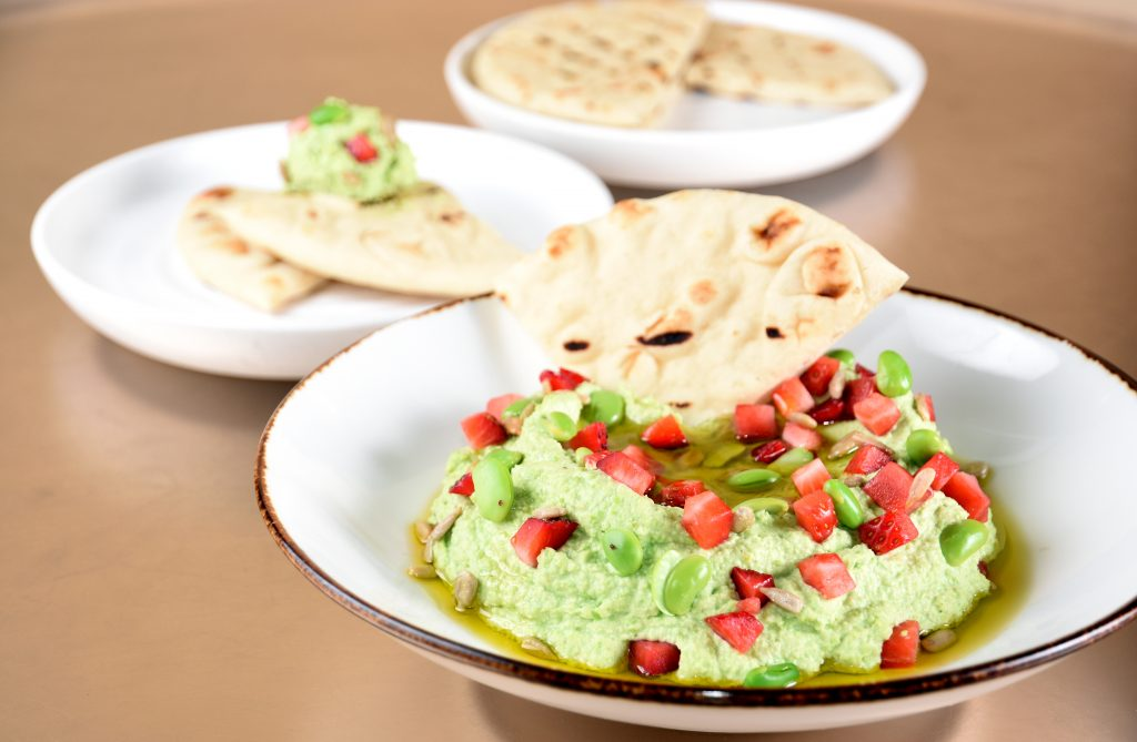 Leonora's edamame hummus with strawberries and sunflower seeds.