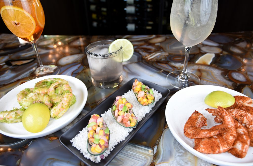 Leonora's yuzu kosho peal n' eat Key West pink shrimp, left, mussels a la chalaca with pico de gallo, old bay peal n' eat Key West pink shrimp with cocktails aperol bel, left, valoma, and pamplemousse and circumstance.