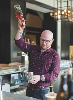 Beverage director, Steven Teaver mixes up his version of an old fashion at The Remedy in The Four Seasons in Vail.