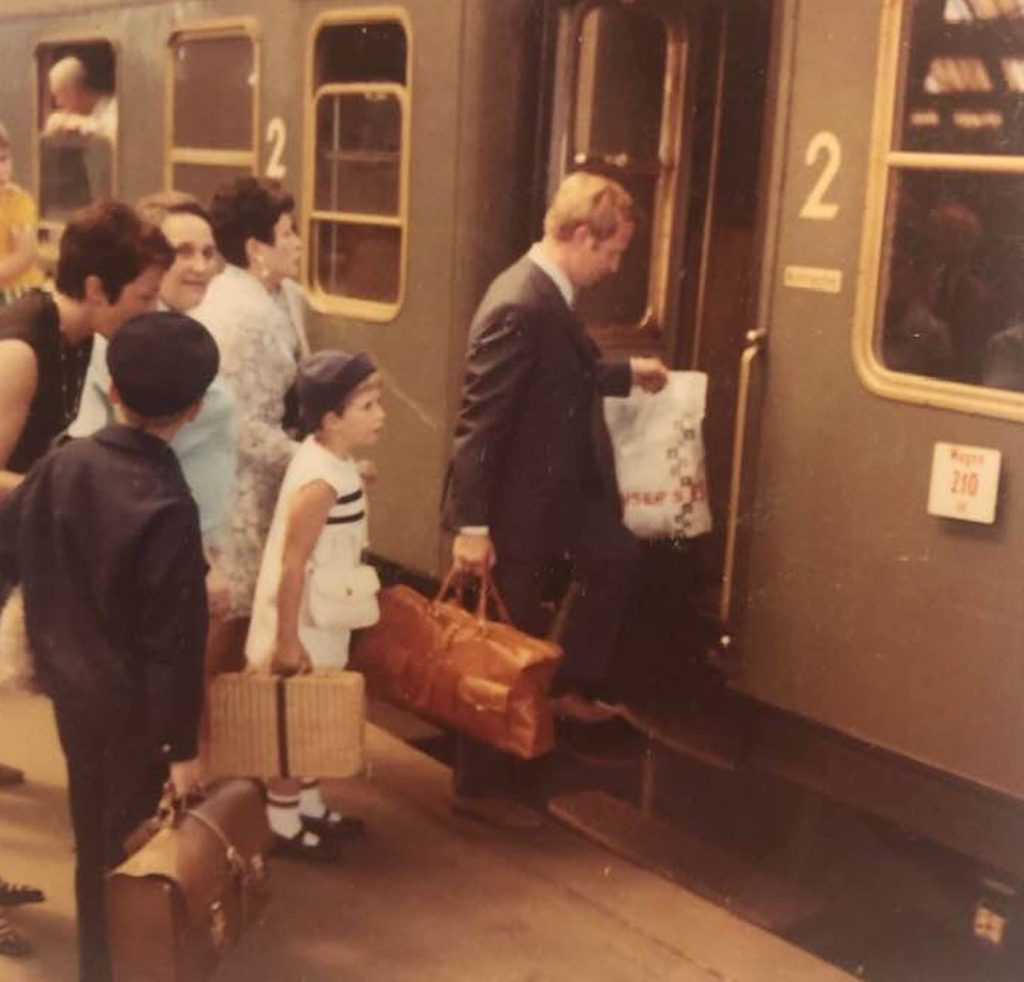 Helmut leads the way onto the train as the Fricker family leaves Germany 50 years ago to immigrate to the United States.