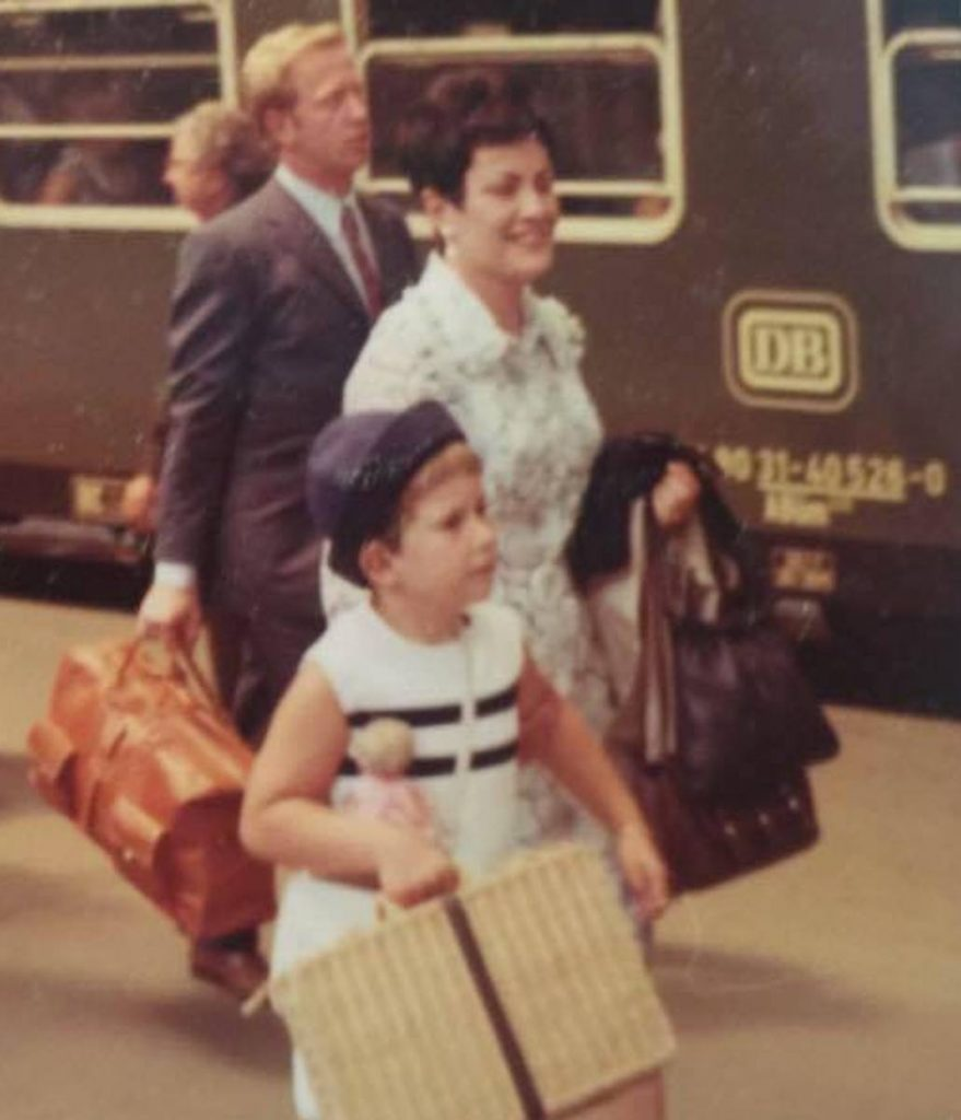 Helmut, Ursula, Susie and Harald Fricker board a train to immigrate from Germany to the United States.