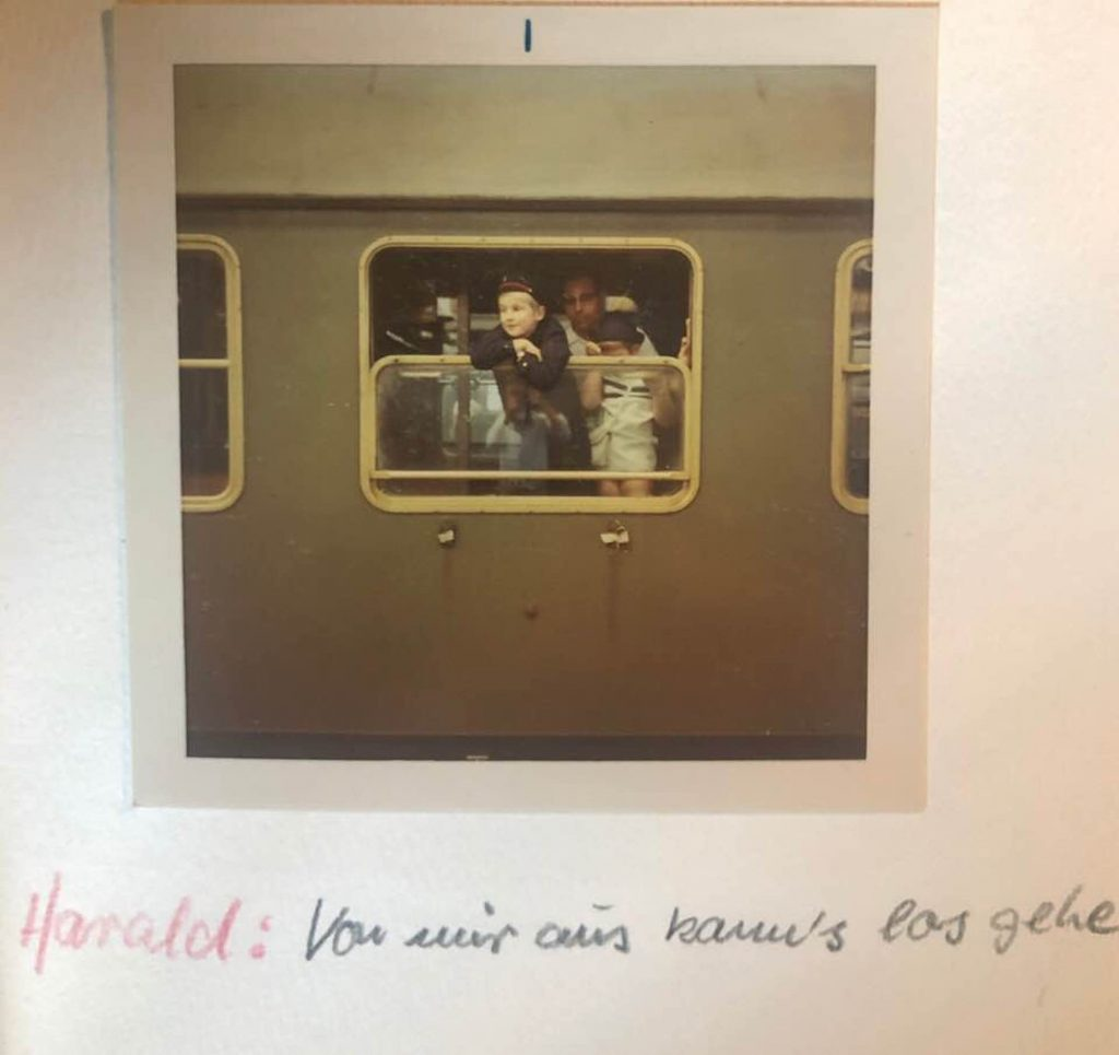 That's 9-year old Harald Fricker, Helmut and Ursula's son, looking out the train window, with Susie beside him, as the family leaves Germany to immigrate to the United States.