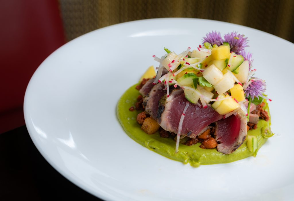 Coriander Tuna | seared rare, sweet potato, house chorizo, chayote squash, mango slaw, avocado from Maya in Avon.