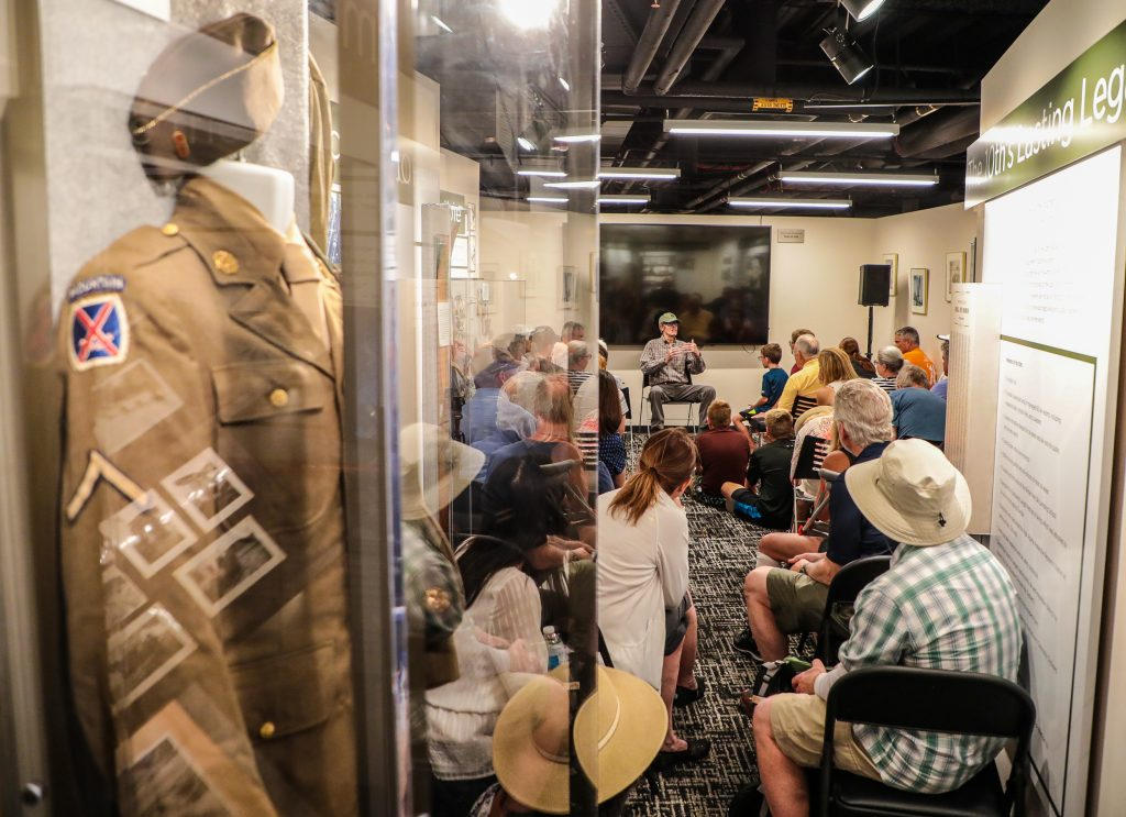 World War II and 10th Mountain Division veteran, Sandy Treat, is greeted by a full house Friday at his weekly talk at the Colorado Snowports Museum in Vail. Treat speaks every Friday.